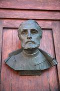 a bust on the door of mariacki door - stock photo