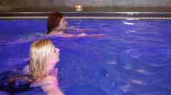 Women in wellness and Spa swimming pool - stock footage