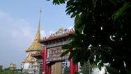 Stock Video Footage of Entrance China town Bangkok with the Phra Maha Mondop Wat Traimitr Witthayaram