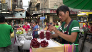 Stock Video Footage of Man selling fresh fruit juice in China town Bangkok