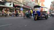 Stock Video Footage of Busy street with a pan following a tuk tuk in China town Bangkok