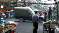 Busy street and crossing in China town Bangkok Stock Footage