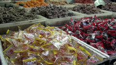 Pan from Candy in China town Bangkok Stock Footage