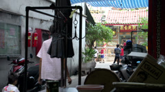 Family walking in the small streets of China town Bangkok Stock Footage