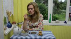 Woman drink herbal camomile tea in rural homestead veranda Stock Footage