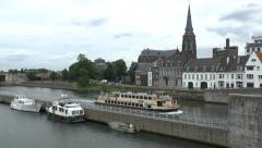 Tourist cruise boat on the Meuse river in Maastricht, Limburg, the Netherlands. Stock Footage