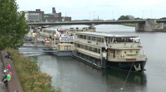 Tourist cruise boats moored on the Meuse river, Maastricht, Netherlands. Stock Footage