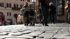 Close up feet, pebbled Rome back street Stock Footage