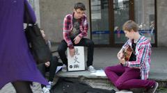 Teenagers play drum guitar girl sing public audience in street Stock Footage