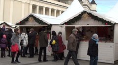 Annual winter holiday market white wooden houses and people Stock Footage