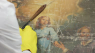 Stock Video Footage of restorer at work on damaged ancient painting