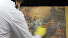 Restorer at work on ancient painting Stock Footage