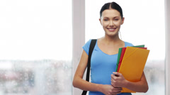 Student with bag and folders showing thumbs up Stock Footage