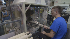Louisville Slugger Baseball Bat being branded at the factory Stock Footage