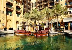 View of the souk madinat jumeirah and abra boats, dubai, uae Stock Photos