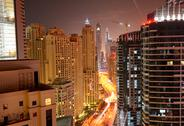 Stock Photo of the view on dubai city from skyscraper in night illumination, dubai, uae
