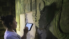 Archaeologist used tablet for notes Stock Footage