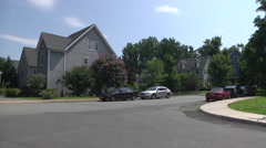 Neighborhood houses street intersection Stock Footage