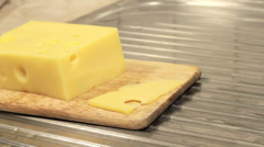 Slicing cheese Stock Footage