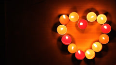 Candlestick encrusted heart shape - stock footage