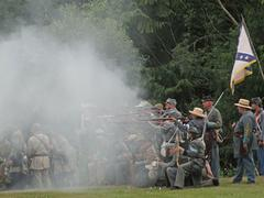 Confederate civil war reenactors fire  their weapons Stock Photos
