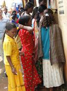 young women shop in the weekly market - stock photo