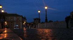Ambulance over Rome bridge at night Stock Footage