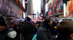 People anxiously wait to to enter Times Square before New Years Eve - stock footage