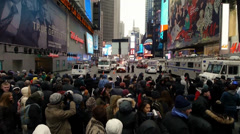 People anxiously wait to to enter Times Square before New Years Eve Stock Footage