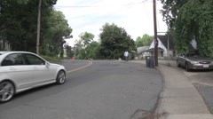 Neighborhood street cars pedestrian Stock Footage