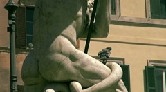 Zoom out and pigeons statue of Neptune in Piazza Navona in Rome Stock Footage
