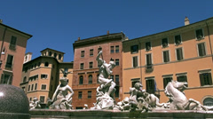 Pigeon on the statue of Neptune in Piazza Navona in Rome Stock Footage