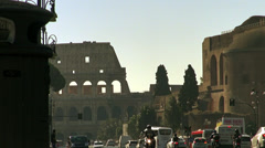 Intense traffic during rush hour near Colosseum, Rome Stock Footage