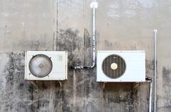 Old air conditioner on concrete wall Stock Photos