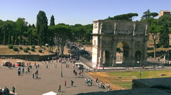 Traffic and rush hour of Arch of Constantine at the Colosseum Stock Footage