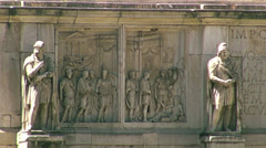 Stock Video Footage of Traffic and rush hour of Arch of Constantine at the Colosseum