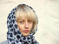 pretty blonde in a spotty scarf. - stock photo