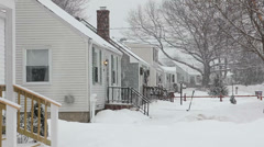 Snow falling on a row of houses Stock Footage