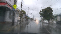 Driving POV heavy rain, suburban Stock Footage