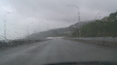Driving POV heavy rain on highway Stock Footage