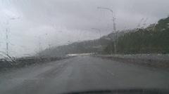 Driving POV heavy rain on highway Stock Footage