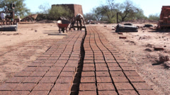 Adobe Brick Making Mud Loading Dolly Stock Footage