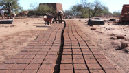 Stock Video Footage of Adobe Brick Making Mud Loading Dolly
