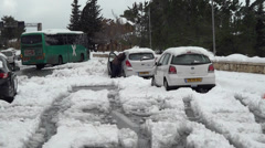 Cars stuck in snow Stock Footage