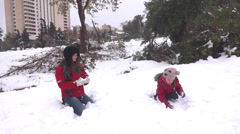 Girls play in snow Stock Footage