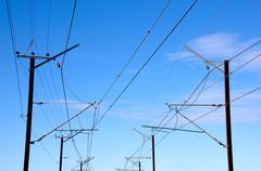 overhead power lines providing power to electric trains - stock photo