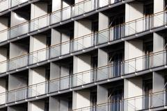 regular structure of windows and balconies - stock photo