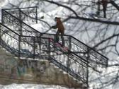 Stock Video Footage of snowboarder rides on the rails