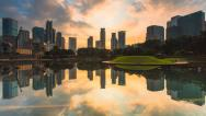 Stock Video Footage of Timelapse Of Cloudy Sunrise At Symphony Lake in KLCC, Kuala Lumpur