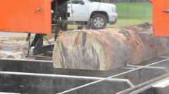portable sawmill cutting a log - stock footage